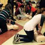 Montessori Middle School Of Kentucky Photo #5 - Students learn CPR and first aid from the local fire department as part of their study on health and well-being.