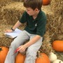 Fortune Academy (formerly The Hutson School) Photo #4 - Taking measurements at the Fortune Pumpkin Patch!