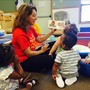 South Arlington Heights KinderCare Photo #2 - Our Infant teachers help promote early language development by talking with our babies, singing songs, and reading books.