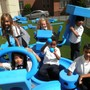 St Brigid School Photo #6 - Ist grade students enjoying the play system in our schoolyard.