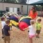 First Baptist Child Development Center Photo #6 - More fun on the playground.