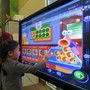 Cranium Academy of Winter Garden Photo - Student using Cranium's interactive technology to learn about math and money.