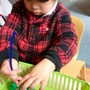 International Montessori Schools At Great Valley Photo - A Pre-Primary child concentrates on a practical life piece of work