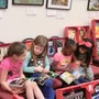 Las Cruces Academy Photo - Kindergarteners diving into new books at our in-house book fair