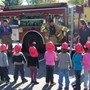 Trinity Christian Preschool Photo #1 - Preschoolers enjoying a visit from the local fire department. They taught children about fire safety.
