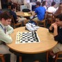 Cardinal Newman High School Photo #3 - students challenging teachers and staff to a game of chess!