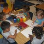 North Elston KinderCare Photo - The children are creating their own masterpieces in our Discovery Preschool classroom.