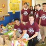 St. Charles Borromeo Catholic School Photo - Compiling food cans to go to the Forester's Feeding God's Children donation drive.