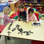 St. John Lutheran Early Learning Center Photo #9 - Manipulatives help children learn math concepts and operations. Here dominoes are being used for that purpose.